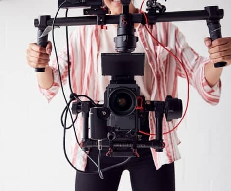 Women is making video with camcorder