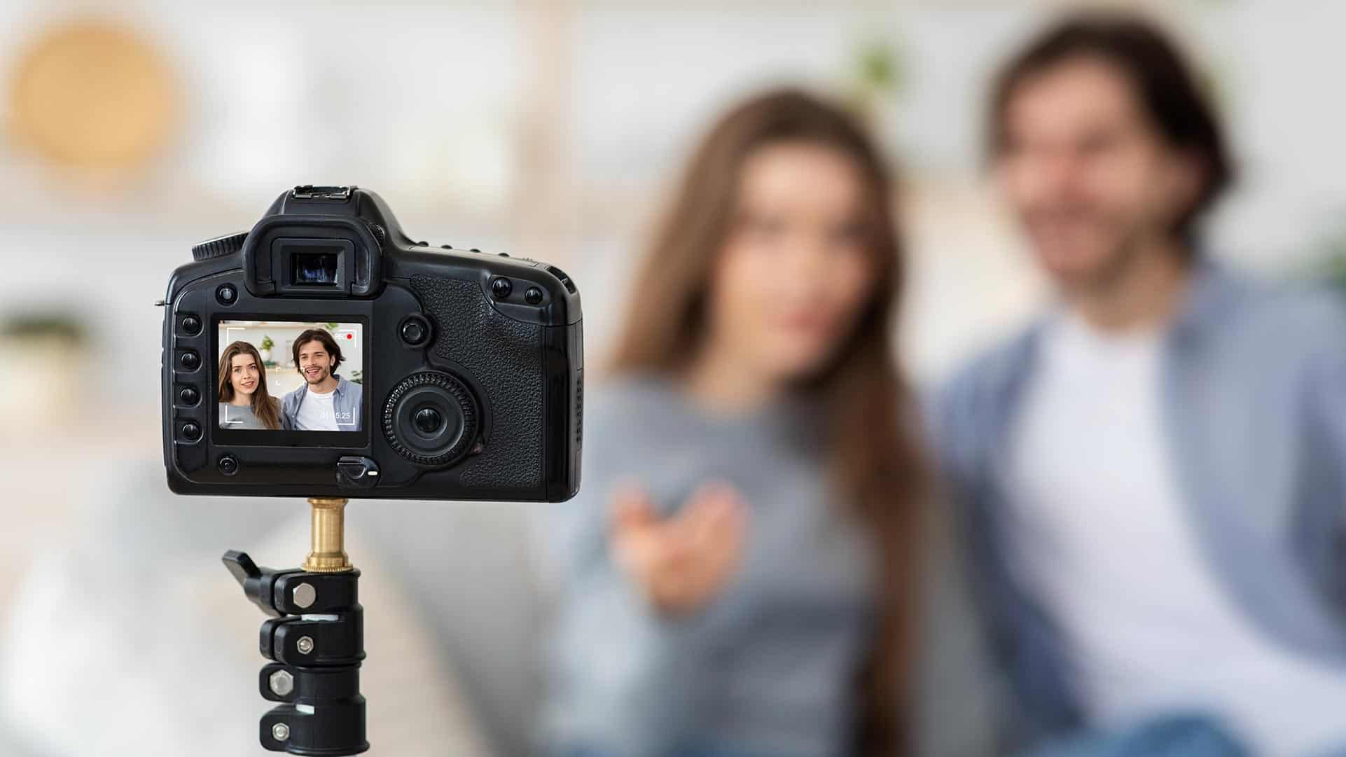 selective focus on camera filming couple while video production is going