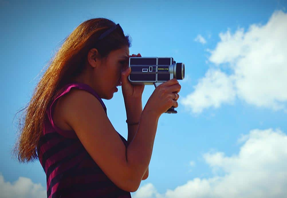 a  filmmaker with old school film camera