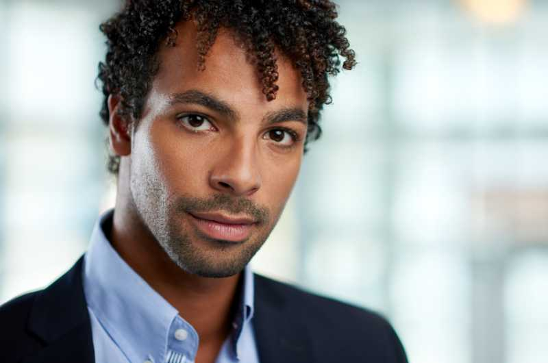 Headshot Photography -Horizontal Headshot Of An Attractive African American Businessman Shot With Shallow Depth Field.