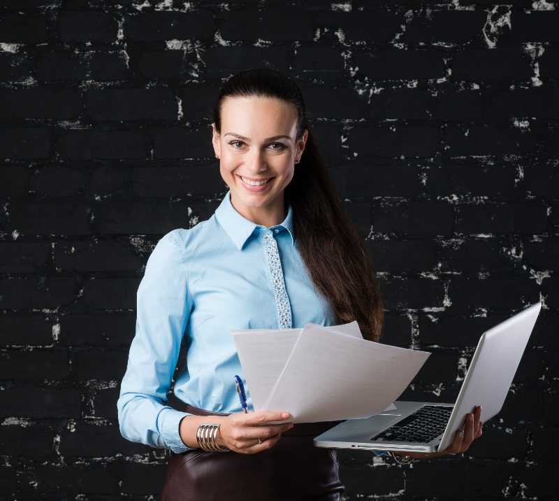 Headshot Photography Portrait Of A Young Business Woman Looking At Camera
