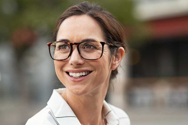 Headshot Photography - Smiling Business Woman With Spectacles